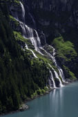 View of the great waterfall from the high trail above Lake Oeschinensee, above Kandersteg, Switzerland