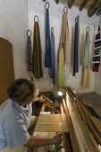 A volunteer weaves silk at the Ballenberg Open-Air Museum, Switzerland