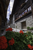 Summer flowers decorate a historic building in Grimentz, Sinale Valley, Switzerland