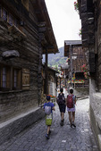 Tourists roam the historic buildings of Grimentz, Sinale Valley, Switzerland