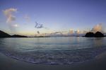Sunrise rainbow and moonset at Trunk Bay, US Virgin Islands National Park, St. John, US Virgin Islands