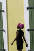 Woman walking on Main Street in Old Town, Charlotte Amalie, St. Thomas, US Virgin Islands