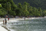 Tourists play on the beach at Magen's Bay, St. Thomas, US Virgin Islands