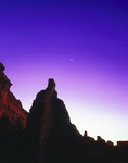 The crescent moon and Venus appear as jewels over Pueblo Bonito in re-dawn light, Chaco Canyon NHP, New Mexico