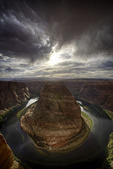 Spring rain falls over the Colorado River at Horseshoe Bend, Page, Arizona