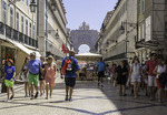Tourists walk on Augustus Street near the waterfront in Lisbon, Portugal