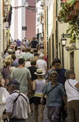 Tourists roam in the Alfama District, Lisbon, Portugal
