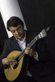 Master musician Antonio 'Toze' Jose plays 12-string guitar during a performance of Fado music, at the Republica da Saudada restaurant in Coimbra, Portugal