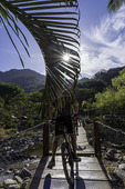 Ecoriders crossing the swinging bridge over the Rio Cuale, Puerto Vallarta, Mexico