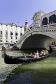 A gondola ride under the Rialto Bridge, Venice, Italy