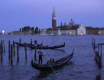 Gondolas ply the waters of the Grand Canal at twilight, Venice, Italy
