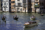 Gondolas and water taxis ply the waters of the Grand Canal by the Rialto Bridge, Venice, Italy