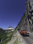 Red Jammers drive down the Going-To-The-Sun Highway below Logan Pass, Glacier NP, Montana
