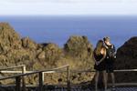 A couple eyes the view from the volcano on Bartolome Island, Galapagos, Ecuador