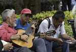 Strumming with friends in Plaza Grande, Old Town, Quito, Ecuador