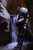 Ascending the first ladder and waterfall in Kanarra Canyon, Utah