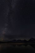 The Milky Way and a meteor in June, above Jackson Lake, Grand Teton NP, Wyoming