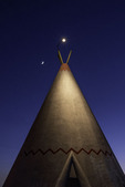 Crescent moon and Venus over a teepee at the Wigwam Motel, Route 66, Arizona