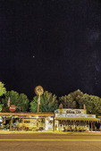 Mars rises above Delgadillo's Snowcap Drive-Inn, on Route 66 in Seligman, Arizona