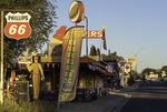 Sunrise comes to Delgadillo's Snowcap Drive-Inn, on Route 66 in Seligman, Arizona