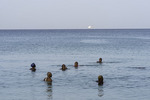 Friends take a morning bath in the ocean off Carlisle Beach, Bridgetown, Barbados