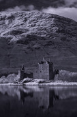 Kilchurn Castle looms beside Loch Awe, Scotland