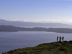 Hikers view the Sound of Raasay from Trotternish, Isle of Skye, Scotland