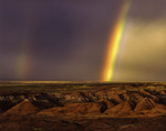 Monsoon rainbow over the Painted Desert, Petrified Forest National Park, Arizona