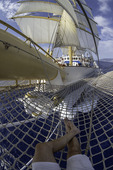 Chilling in the bow net on the Royal Clipper, Mediterranean Sea off western Italy