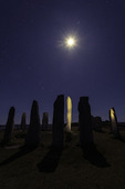 Stars above and moon shadow cast by the Calanais Standing Stones, Isle of Lewis, Scotland