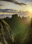 Sunrise over the North Sea on Dunnottar castle, Scotland