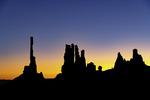 Sunrise glow behind the Totem Pole and Yei Bi Chei, Monument Valley, Arizona