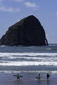 Surfers near Cape Kiwanda, Oregon