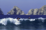 Surfing with El Arco in the background, Cabo San Lucas, Baja California Sur, Mexico