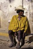 Tarahumara man, fixing his shoes in Batopilas, Copper Canyon region, Mexico