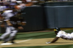 Rickey Henderson steals 3rd base at the Oakland Coliseum, California
