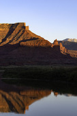 Last light on Fisher Towers, reflected in the Colorado River, Utah