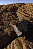 Desert varnished boulder on sandstone at Snow Canyon State Park, Utah