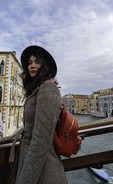 A woman poses for friends on the Accademia Bridge, Venice, Italy