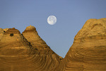 Moonset over cross-bedded sandstones at Coyote Buttes North, Arizona