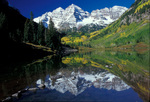 Light snow on Maroon Bells with reflection in Maroon Lake [Fall season]