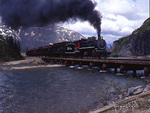 Passenger train with steam engine No.73, 1947 Baldwin 2-8-2 , crossing  Thompson River,White Pass & Yukon Route Railway, British Columbia, Canada