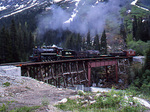 Photo freight special with steam locomotive No.73, 1947 Baldwin 2-8-2 , crossing Skagway River ,  White Pass & Yukon Route Railway , Glacier, Alaska