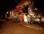Night image of steam locomotive No.300, 1917 Baldwin 2-8-0, pulling the Polar Express TM train, Texas State Railroad, Palestine Depot, Texas