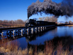 Steam locomotive No.18 ,1910 Alco 2-8-0 , with Special Photo Freight crossing the Rio Grande River, Alamosa, Colorado.