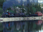 Photo freight special with steam locomotive No.73, White Pass & Yukon Route Railway, along Lake Fraser, British Columbia, Canada