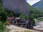 Excursion train with steam locomotive No.73, 1947 Baldwin 2-8-2, White Pass & Yukon Route Railway,  East Fork of the Skagway River, Alaska