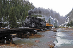 Durango & Silverton Narrow Gauge RailroadTM train with steam locomotive No.480, 1925 Baldwin 2-8-2, Animas River Bridge, Spring season, Colorado