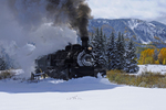 Steam locomotive double-header No.488 and No.487, 1925 Baldwin 2-8-2 K-36, plowing fresh snow with Fall Aspens in the background, Cumbres & Toltec Scenic Railroad, Colorado