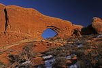 View of sunset light on the North Window, Winter season, Arches National Park, Utah